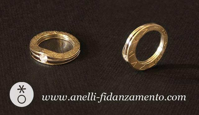 Anello personalizzato in oro bicolore con il nome inciso sul fianco. Creato da Eva.